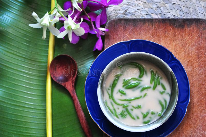 Cendol Traditional Dessert on Wooden Board with Space for Text. Cendol traditional dessert on wooden board with banana leaf and orchid on background with space royalty free stock photos