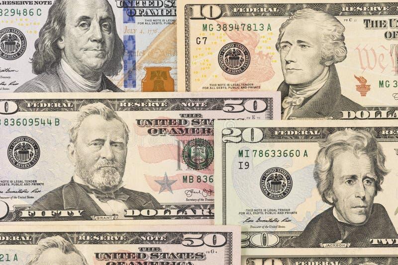 Cenni storici dei soldi Dollari misti di carte in denaro fotografie stock libere da diritti