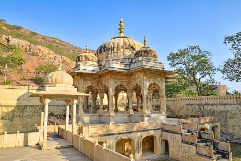 Cenotaph shaded by trees, Royal Gaitor, Jaipur, Rajasthan. One mainly beige cenotaph shaded by trees at the Royal Gaitor, Jaipur, Rajasthan, India royalty free stock photos
