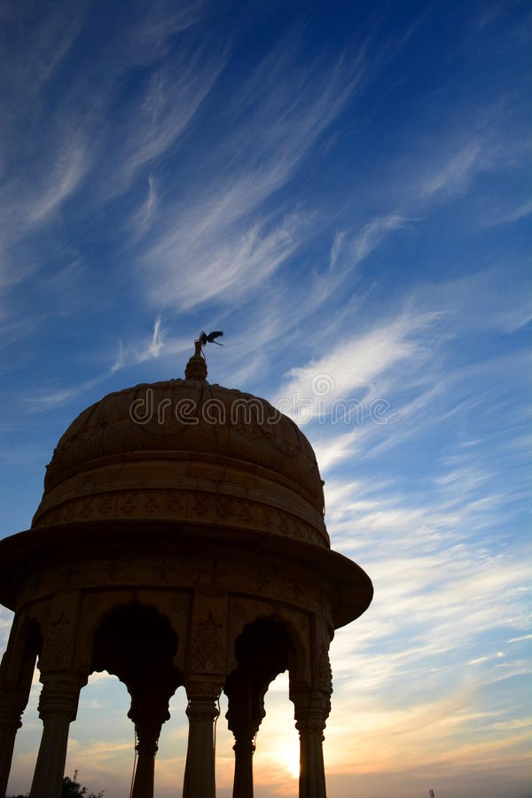 Cenotaph silhouette at sunset. Jaisalmer. Rajasthan. India. Jaisalmer, nicknamed The Golden city, is a city in the Indian state of Rajasthan. The town stands on royalty free stock image