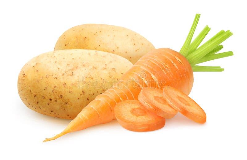 Cenoura e batatas cruas isoladas fotografia de stock royalty free