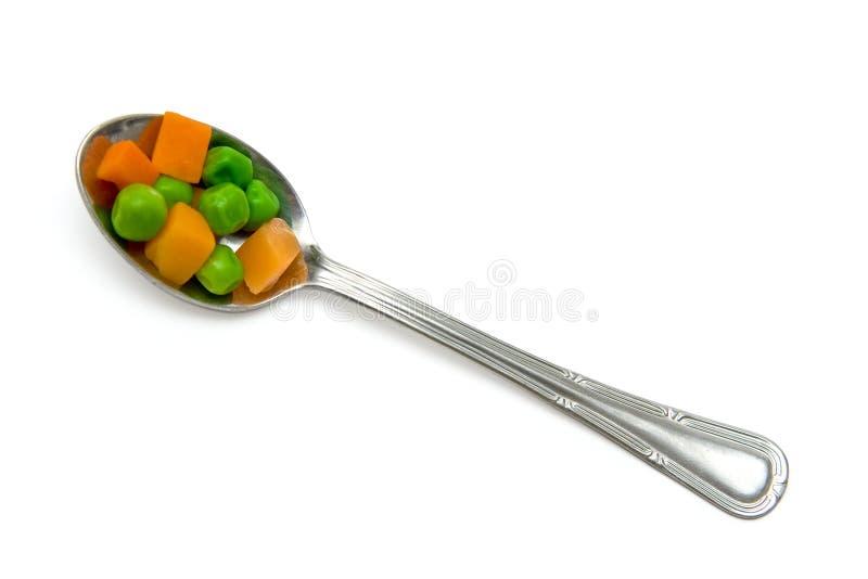 Cenoura e ervilhas verdes imagem de stock