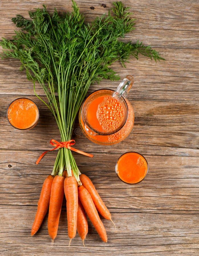 Cenoura e suco de cenoura fotografia de stock