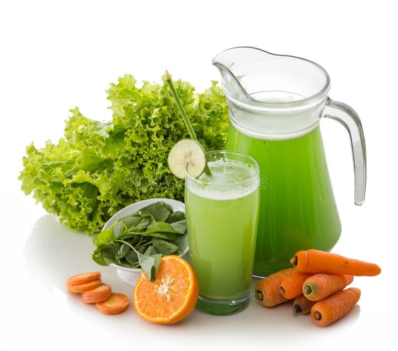 Cenoura, Lettuse e suco da mistura dos espinafres foto de stock