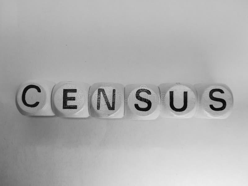 Censo de la palabra deletreado en dados fotografía de archivo