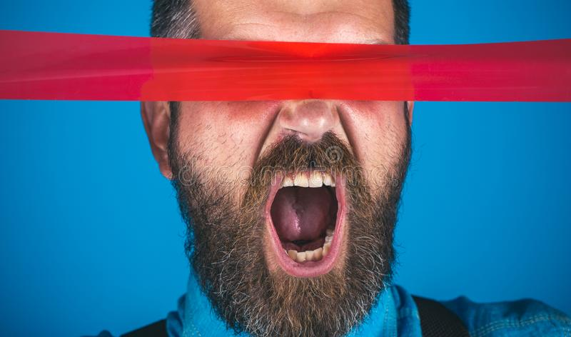 Censorship. Brutal bearded male. man wrapping mouth by adhesive tape. International Human Right day. Concept freedom of. Speech and press. Mind control and stock photo