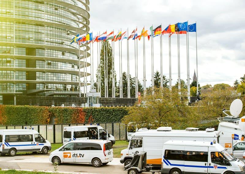 Censure police officers surveilling tv trucks at European Parliament stock photos