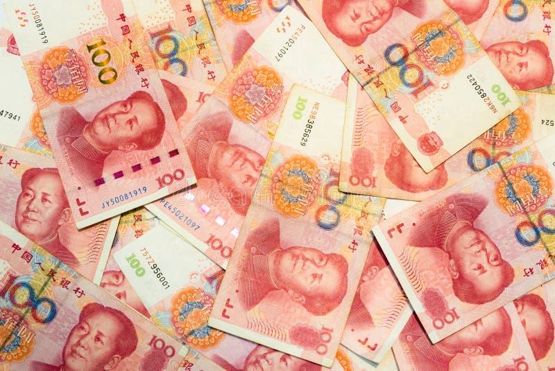 Cent billets de banque chinois de yuans comme fond image libre de droits