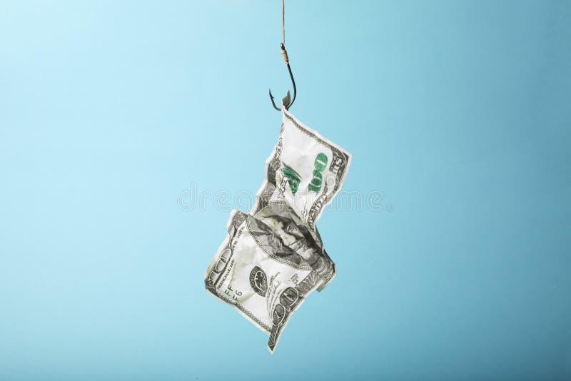 Cent dollars sur le crochet est pi?ge La d?pendance ? l'?gard des pr?ts et des cr?dits images stock