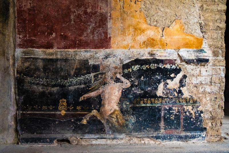 Centaur painted on the wall of a house in Pompeii royalty free stock images