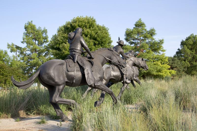 Centennial Land Run Monument sculpture in Oklahoma view. Group bronze sculpture in Centennial Land Run Monument sunset, city Oklahoma USA royalty free stock image