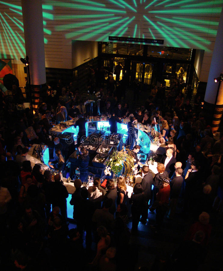 Center bar crowds with people at SFMOMA party royalty free stock photography