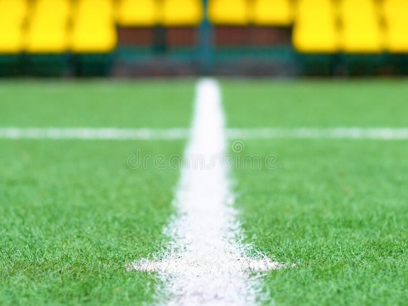 Center of the football field close-up. In the distance, you can see the spectator stands stock images