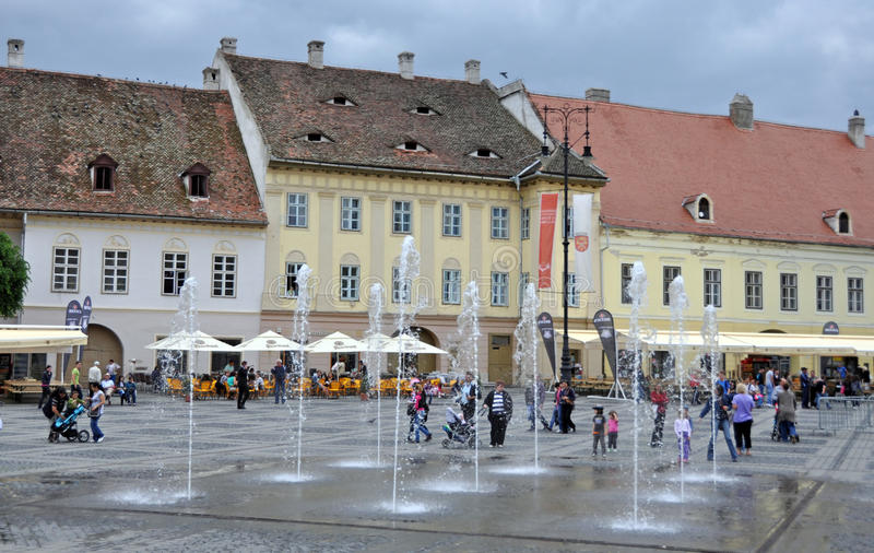 Center fountain. Sibiu city - big square - in middle Romania, Transylvania land is now host of International Festival of Theater May 25th - June 3rd 2012 royalty free stock image