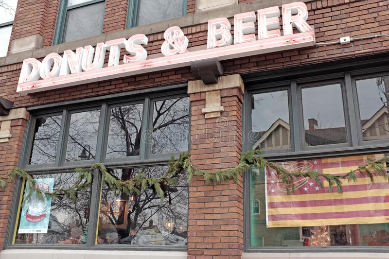 Donuts and Beer sign outside Brewnuts, a trendy donut shop with beer-infused donuts in Cleveland, Ohio, USA stock photography