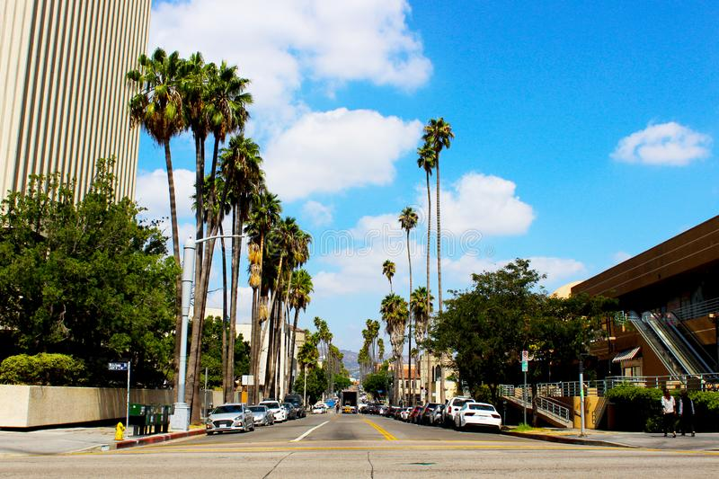 The center of the Koreatown area in Los Angeles. View of the roadway and the in. Tersection. The road to Hollywood with tall palm trees. Los Angeles, California stock images
