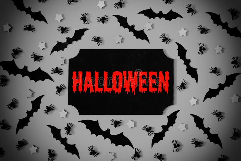 In the center of the photo black plate. On the plate the inscription in red letters is Halloween. royalty free stock photography
