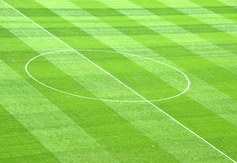 Center Spot. Detail from a soccer field showing the center spot and circle stock images