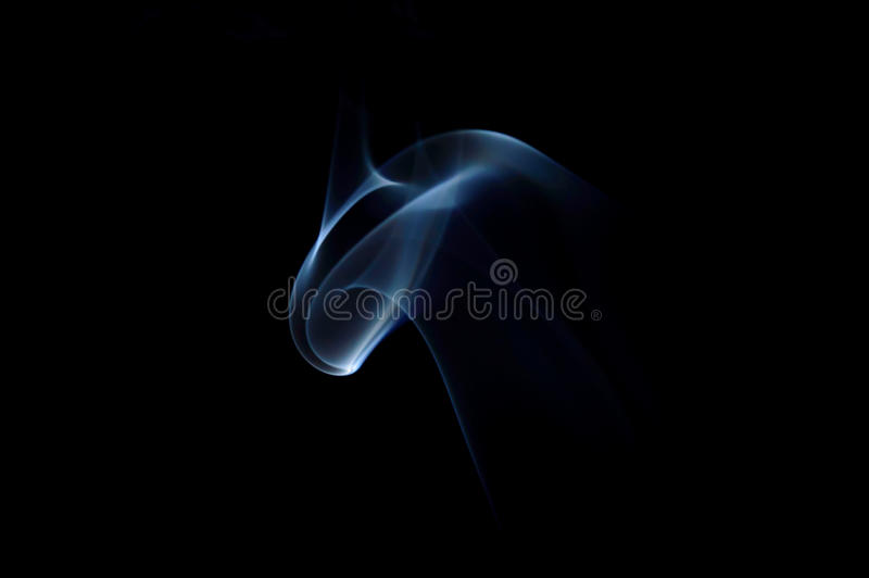 Centered blue abstract swirly smoke art plume. On a black background stock photography