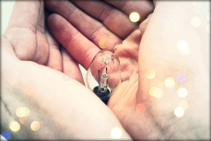 Centered Clear Bulb On Human Hand Free Public Domain Cc0 Image