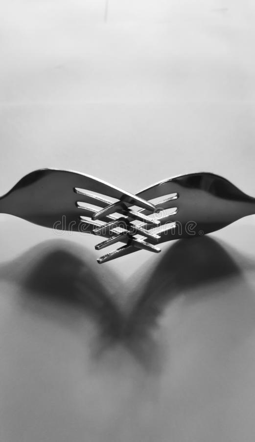 Centered fork spoon royalty free stock photography