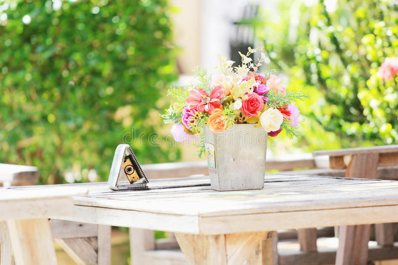 Flower vase placed on a classic wooden table. stock photo