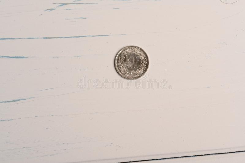 A 50 centimes Swiss coin lying on a wooden table royalty free stock images
