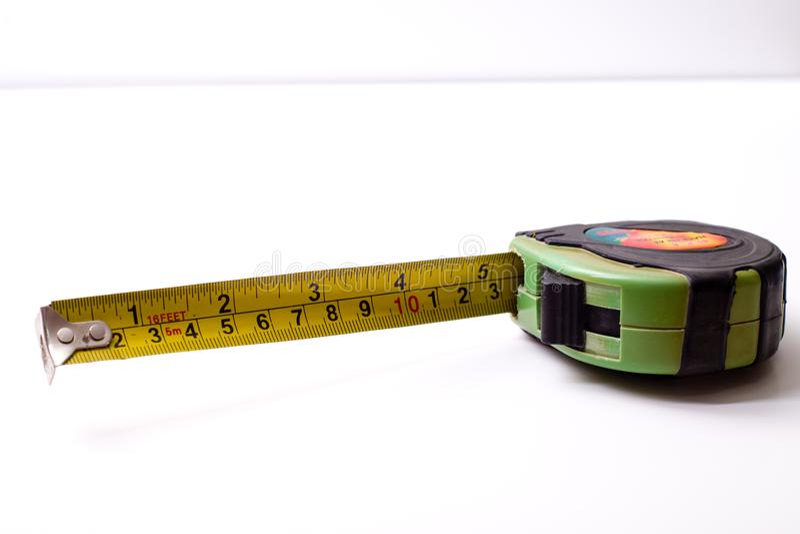Measuring ruler. A centimeter measuring ruler on white background royalty free stock photo