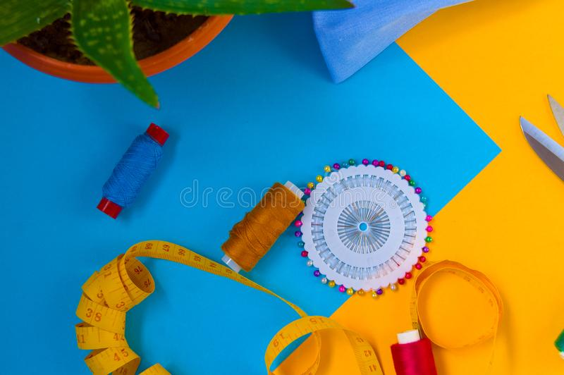 Centimeter, thread, needle and flower, sewing tools stock photo