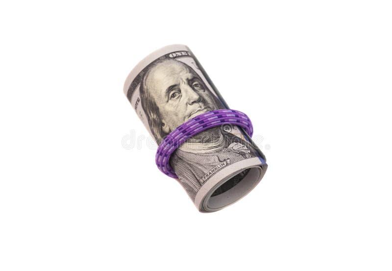 Cento banconote in dollari acciambellate con rubberband fotografia stock
