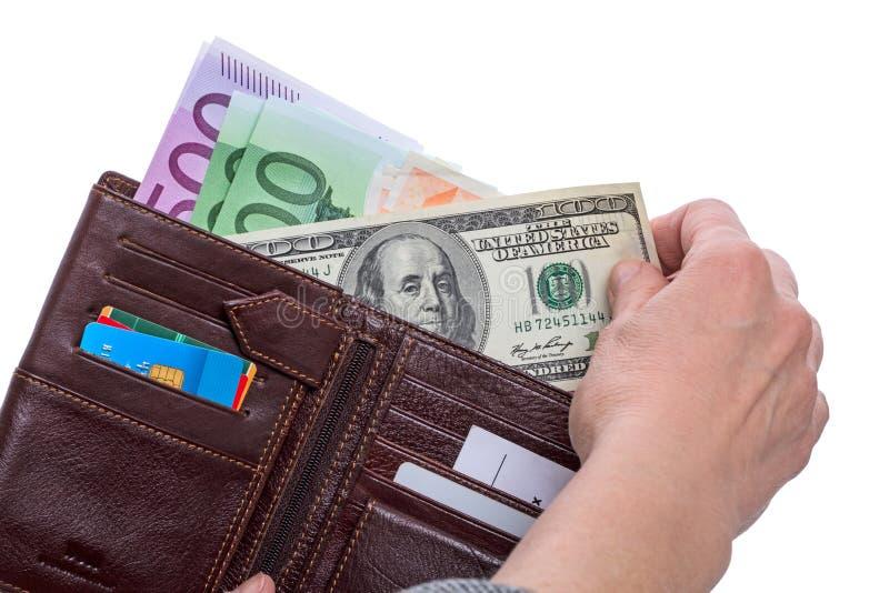 Cento dollaro e portafogli con le euro banconote immagini stock libere da diritti