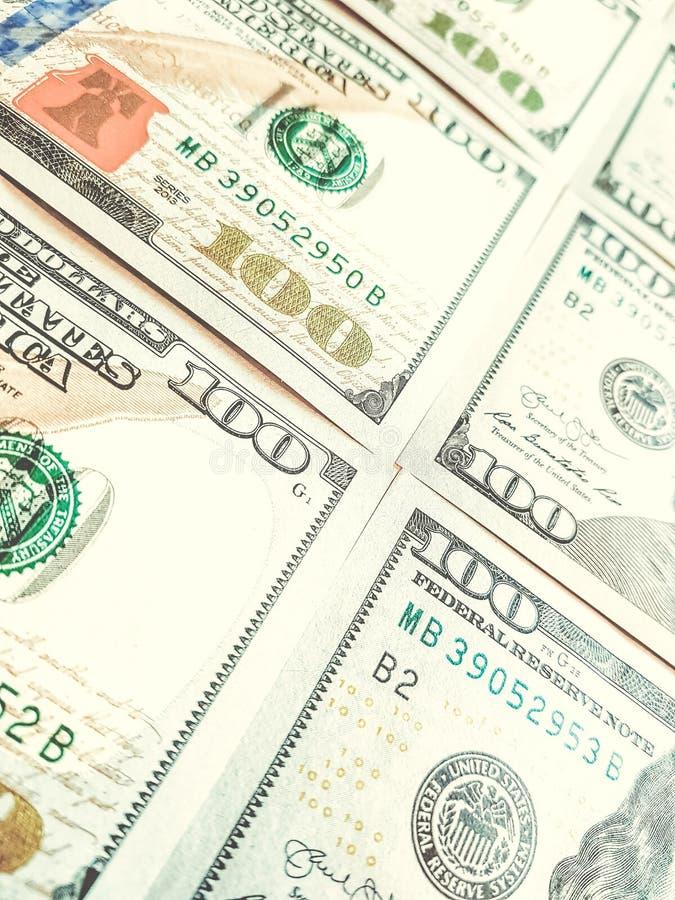 Cento macro fondi sparati delle banconote in dollari fotografia stock libera da diritti