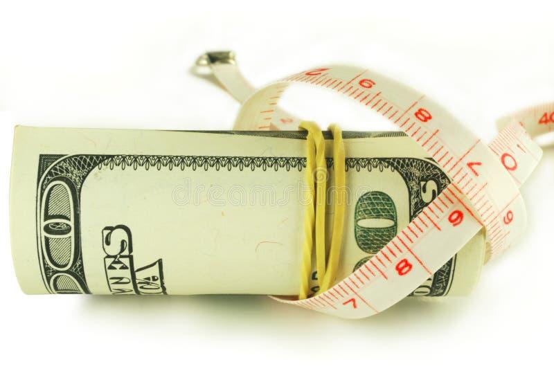 Cento rotoli della banconota in dollari - il dollaro si sviluppa leggermente