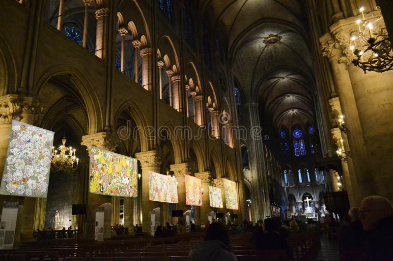 Central nave of the Notre-dame Cathedral in Paris decorated with paintings for Christmas. royalty free stock photos