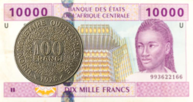 100 central african CFA franc coin against 10000 central africa. N CFA franc bank note obverse, specimen stock photography