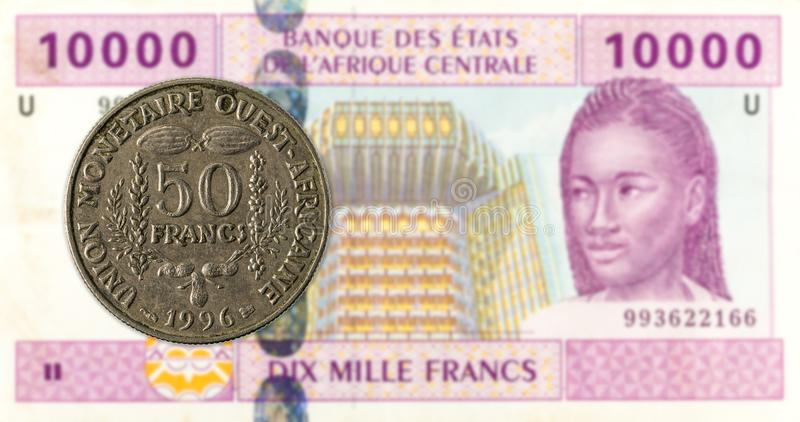 50 central african CFA franc coin against 10000 central africa. N CFA franc bank note obverse, specimen royalty free stock photos