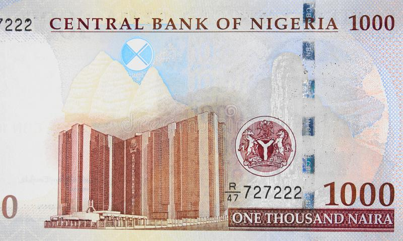 Central Bank of Nigeria corporate Head Office in Abuja on Nigerian 1000 naira (2016) banknote closeup macro, Nigerian money close royalty free stock image