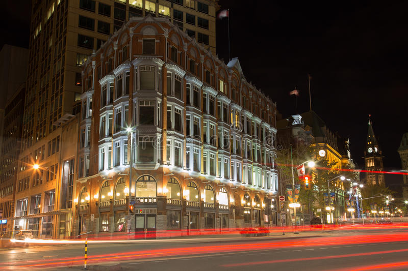 Central Chambers Building - Ottawa. OTTAWA, CANADA - 12TH OCTOBER 2014: The outside of the Central Chambers buildings in Ottawa along Elgin Street at night royalty free stock photo