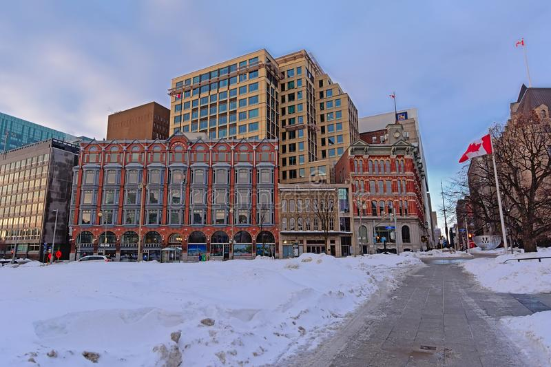 Central Chambers in Queen Anne revival style and modern buildings along Elgin street, covered in snow in Ottawa stock photos