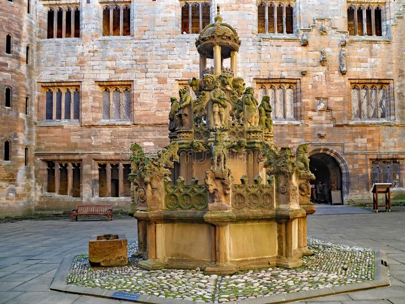 The central courtyard of Linlithgow Palace contains an ornate fountain. With numerous statutes of mythical creatures stock photo