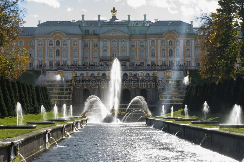 The central fountain in the famous park, Peterhof in Russia. The central fountain in the famous park, during autumn, Peterhof in Saint Petersburg, Russia royalty free stock image