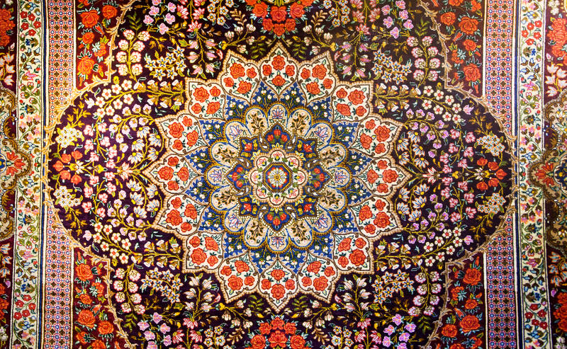 Central fragment of beautiful oriental persian carpet with colorful texture royalty free stock image