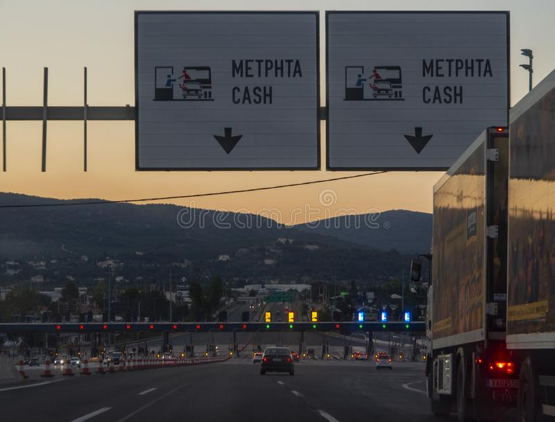 Central Greece. July 2019: Trip on the toll highway Athens-Thessaloniki, past cars, gas stations, toll checkpoints at sunset in th. E summer evening stock photography