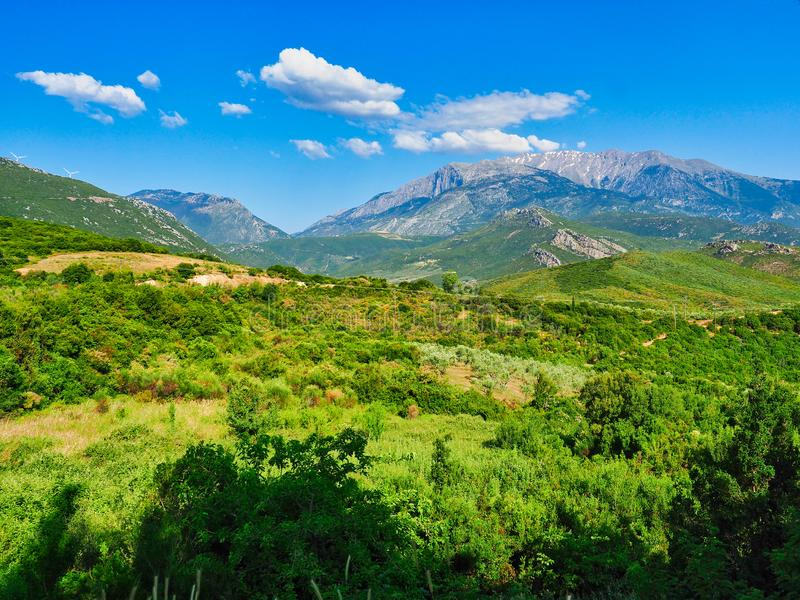 Central Greece Landscape With View to Mount Parnassus, Greece. A green early summer central Greece landscape with distant view to Mount Parnassus with remains of royalty free stock image