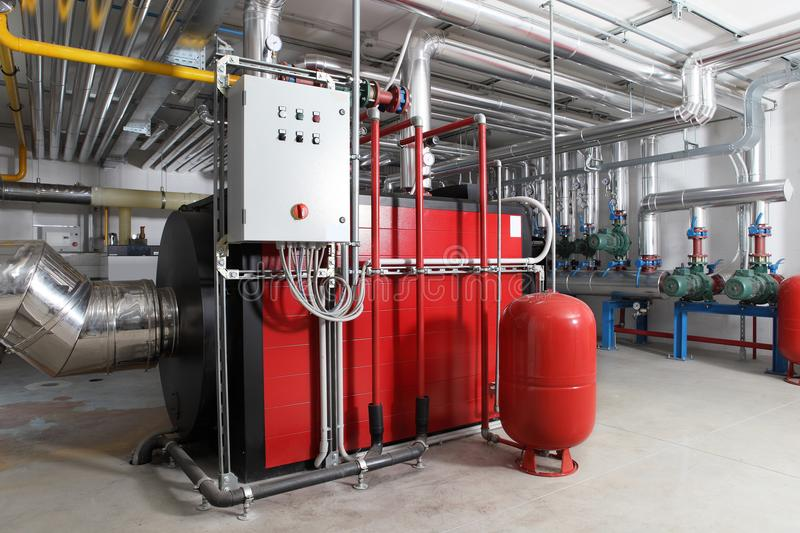 Central heating and cooling system control in a boiler room. Pumps and pipes royalty free stock images