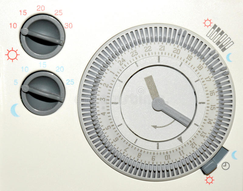Central Heating Timer. Domestic central heating timer control with day and night thermostat royalty free stock image