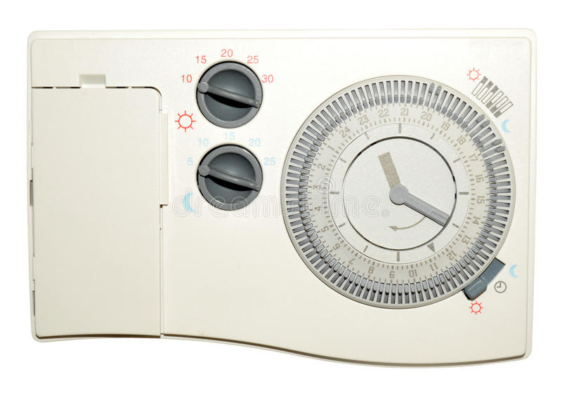 Central Heating Timer. Domestic central heating timer control with day and night thermostat isolated on a white background royalty free stock photography