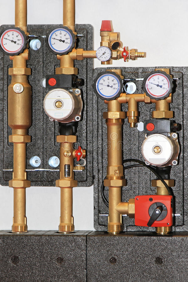 Central heating pump. Central heating unit with pump valves and gauges royalty free stock photos