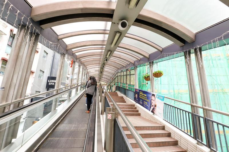 CENTRAL, HONG KONG-FEBRUARY 18, 2018 - Central Mid-Levels escalator is the longest outdoor covered escalator system in the world. stock photo