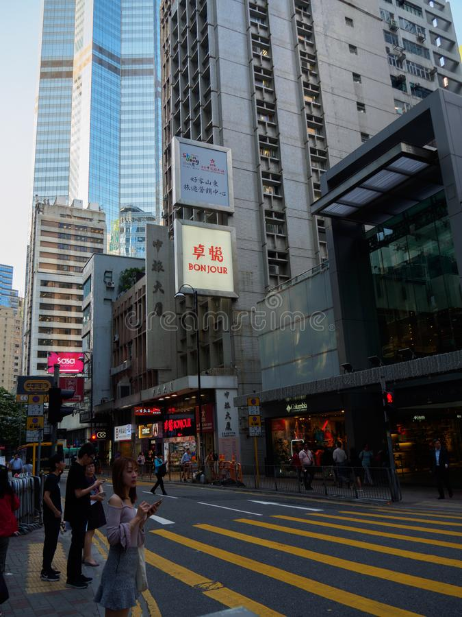 A street scene of Queen`s Road Central in Hong Kong. The busy boulevard is dotted with. Central, Hong Kong - November 1, 2017: A street scene of Queen`s Road stock image